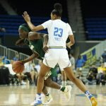 Dekeiya Cohen tries to get around Kelli Hayes. Photo by Maria Noble/WomensHoopsWorld.