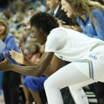 Kayla Owens and Lindsey Corsaro celebrate a call in favor of UCLA. Photo by Maria Noble/WomensHoopsWorld.