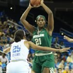 Kalani Brown looks to pass. Photo by Maria Noble/WomensHoopsWorld.