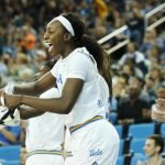 Michaela Onyenwere is joyous about a UCLA basket. Photo by Maria Noble/WomensHoopsWorld.
