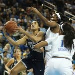 Gabby Williams on the drive. Photo by Maria Noble/WomensHoopsWorld.
