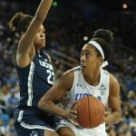 Monique Billings looks to get around Azura Stevens. Photo by Maria Noble/WomensHoopsWorld.