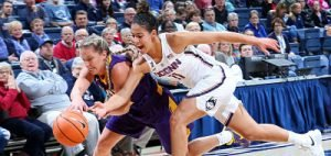 Kia Nurse gets aggressive on defense for the Huskies. Photo courtesy of UConn Athletics.