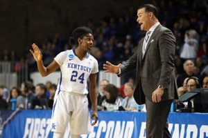 Matthew Mitchell confers with guard Taylor Murray. Photo courtesy of Kentucky Athletics.