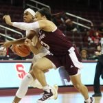 Chennedy Carter guards Minyon Moore. Photo by Maria Noble/WomensHoopsWorld.