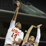 Sadie Edwards drives over Chennedy Carter. Photo by Maria Noble/WomensHoopsWorld.
