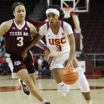 Minyon Moore drives against Chennedy Carter. Photo by Maria Noble/WomensHoopsWorld.
