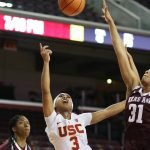 Minyon Moore scores. Photo by Maria Noble/WomensHoopsWorld.