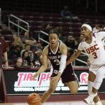 Chennedy Carter is guarded by Minyon Moore. Photo by Maria Noble/WomensHoopsWorld.