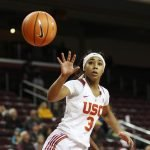 Minyon Moore passes the ball. Photo by Maria Noble/WomensHoopsWorld.