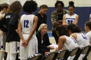 Vanessa Nygaard conducts a timeout, while Ebony Hoffman looks on. Photo by Maria Noble/WomensHoopsWorld.