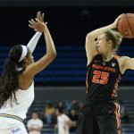 Jordin Canada defends Taylor Kalmer. Photo by Maria Noble/WomensHoopsWorld.