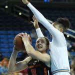 Mikayla Pivec is defended by Kelli Hayes. Photo by Maria Noble/WomensHoopsWorld.