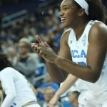 Lauryn Miller applauds a Bruin bucket. Photo by Maria Noble/WomensHoopsWorld.