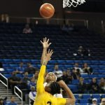 Jordin Canada scores over Mikayla Cowling. Photo by Maria Noble/WomensHoopsWorld.