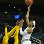 Jordin Canada shoots and scores over the double-team. Photo by Maria Noble/WomensHoopsWorld.