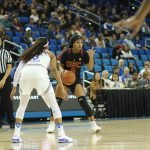 Minyon Moore is guarded by Jordin Canada. Photo by Maria Noble/WomensHoopsWorld.