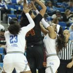 Sadie Edwards is smothered on defense. Photo by Maria Noble/WomensHoopsWorld.