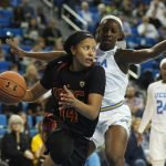 Sadie Edwards tries to get by Michaela Onyenwere. Photo by Maria Noble/WomensHoopsWorld.