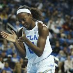 MIchaela Onyenwere claps after a call. Photo by Maria Noble/WomensHoopsWorld.