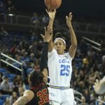 Monique Billings shoots over Kristen Simon. Photo by Maria Noble/WomensHoopsWorld.