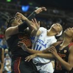 Kristen Simon, Lajahna Drummer and Aliyah Mazcyk battle for the rebound. Photo by Maria Noble/WomensHoopsWorld.