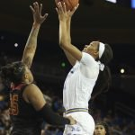 Lajahna Drummer goes up over Kristen Simon. Photo by Maria Noble/WomensHoopsWorld.