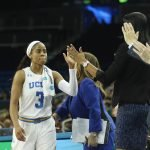 Jordin Canada slaps hands as she comes out of the game. Photo by Maria Noble/WomensHoopsWorld.