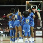 Bruins huddle. Photo by Maria Noble/WomensHoopsWorld.