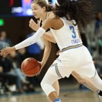 Jordin Canada defends Kennedy Leonard. Photo by Maria Noble/WomensHoopsWorld.