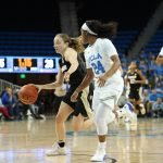 Japreece Dean guards Kennedy Leonard. Photo by Maria Noble/WomensHoopsWorld.