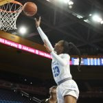 Kelli Hayes scores. Photo by Maria Noble/WomensHoopsWorld.