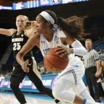 Jordin Canada drives along the baseline. Photo by Maria Noble/WomensHoopsWorld.