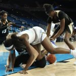 Players scramble for the ball late in the game. Photo by Maria Noble/WomensHoopsWorld.