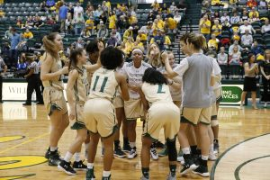 Misha Jones, center, rallies teammates before a game. Photo courtesy of William&Mary Athletics.
