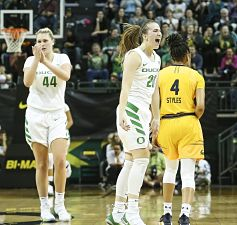Mallory McGwire, left, and Sabrina Ionescu celebrate after a basket in the second half Friday night. Photo courtesy of Oregon Athletics.