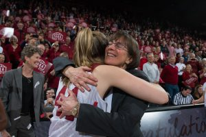 Tara VanDerveer gets a hug from Karlie Samuelson last February after securing her 1,000th career win. Photo by Don Feria/ISIPhotos.com.