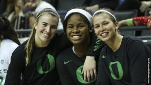 Sabrina Ionescu and Ruthy Hebard joined Lexi Bando, right, in reaching 1,000 career points. Eric Evans Photograhpy/Oregon Athletics.