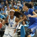 Jordin Canada drives by Jaylyn Agnew. Photo by Maria Noble/WomensHoopsWorld.