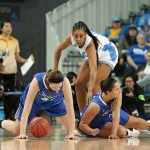 Creighton players begin to rise after a ball scramble. Photo by Maria Noble/WomensHoopsWorld.