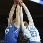 Ali Greene and Kelli Hayes scramble for the rebound. Photo by Maria Noble/WomensHoopsWorld.