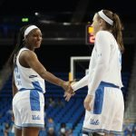 Kennedy Burke and Chrissy Baird share a moment at the end of the game. Photo by Maria Noble/WomensHoopsWorld.