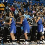 Creighton coaches embrace their seniors as they come out of the game. Photo by Maria Noble/WomensHoopsWorld.