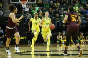 Ruthy Hebard and Sabrina Ionescu initiate the fast break for Oregon. Photo by Eric Evans Photography.