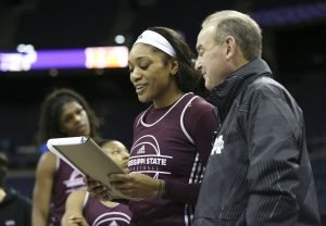 Victoria Vivians and Vic Schaefer confer over Thursday's practice plan. Photo courtesy of Mississippi State Athletics.
