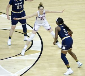 Jackie Young is defended by Katie Lou Samuelson.  Photo by Jamie Thompson/T.G.Sportstv1.