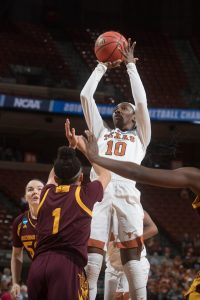 Lashann Higgs elevates for two. Photo courtesy of Texas Athletics.