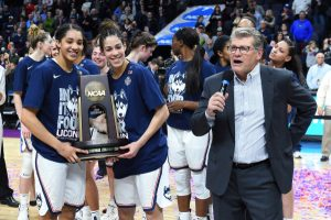 Geno Auriemma and the UConn Huskies celebrate after winning the Albany regional. Photo courtesy of Connecticut Athletics.