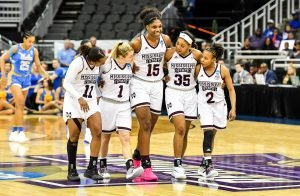 As they close in on the win in the game's final minutes, Mississippi State starters embrace as they walk up the court together. Photo courtesy of Mississippi State Athletics.