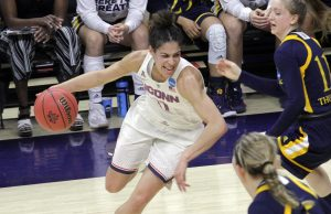 Kia Nurse drives into the paint. Photo by Bob Stowall.